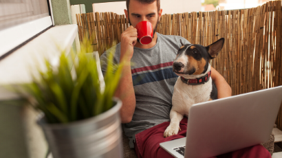 Man working from home with pet dog.
