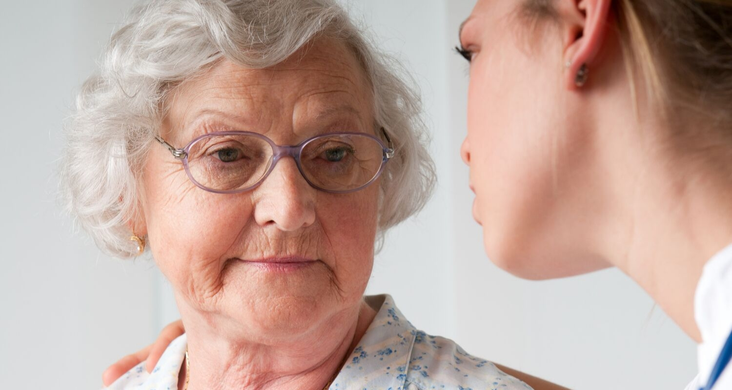 Older woman chatting with doctor