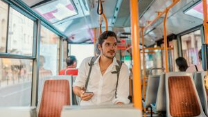 Getting around: man on a bus