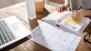 Time management: Person organising calendar and schedule