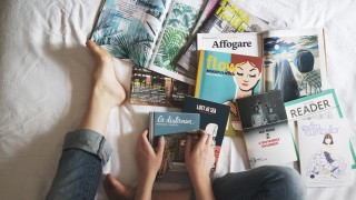 Canva---Flay-lay-of-Woman-Reading-Magazines-on-Bed